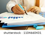 auditor is checking financial... | Shutterstock . vector #1104660431