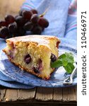 sponge cake with red grapes on a plate - stock photo