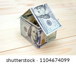 dollars money in the shape of a ...   Shutterstock . vector #1104674099
