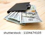 heap of money and wallet. money ...   Shutterstock . vector #1104674105