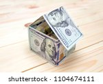 dollars money in the shape of a ...   Shutterstock . vector #1104674111