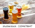 glasses of light and dark beer...   Shutterstock . vector #1104678647