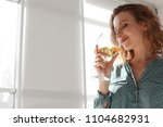 woman with glass of delicious... | Shutterstock . vector #1104682931