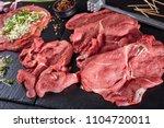 raw braciole   prosciutto ... | Shutterstock . vector #1104720011