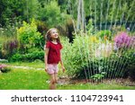 Kid Girl Playing With Garden...