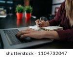 female hand writing on notebook ... | Shutterstock . vector #1104732047