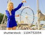fashionable woman wearing blue...   Shutterstock . vector #1104752054