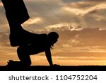 silhouette of a large man's leg ... | Shutterstock . vector #1104752204