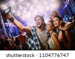 happy friends taking selfie at... | Shutterstock . vector #1104776747