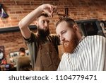 hairdresser does haircut for... | Shutterstock . vector #1104779471