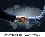 handshake with map of the world ... | Shutterstock . vector #110479439