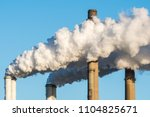 the chimneys of a powerstation... | Shutterstock . vector #1104825671