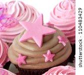 Chocolate cupcake with pink stars. - stock photo