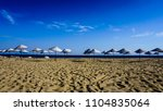number of empty sunbeds with... | Shutterstock . vector #1104835064