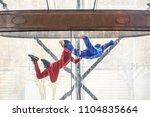 skydivers in indoor wind tunnel ... | Shutterstock . vector #1104835664