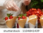 pastry chef is decorating ice... | Shutterstock . vector #1104841439