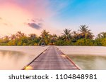 beautiful sunset beach scene.... | Shutterstock . vector #1104848981