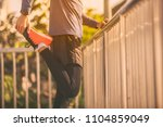 runer with smartwatch at sunset | Shutterstock . vector #1104859049