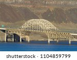 Small photo of I-90 Vantage Bridge over the Columbia River Gorge in central Washington State Wide Angle with blue water rocky dry desert mountain hill Vantage
