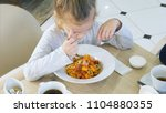 little grimy girl eating... | Shutterstock . vector #1104880355