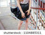 the girl's skirt rises in the... | Shutterstock . vector #1104885311