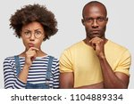 headshot of puzzled african... | Shutterstock . vector #1104889334