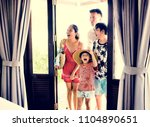 asian family on vacation | Shutterstock . vector #1104890651