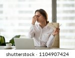 fatigued businesswoman taking... | Shutterstock . vector #1104907424