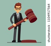 business lawyer holding wooden... | Shutterstock .eps vector #1104917564