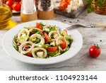 salad with squid rings. front... | Shutterstock . vector #1104923144