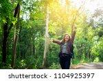 happy smiling wanderlust asian... | Shutterstock . vector #1104925397