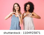 two cheerful young girls... | Shutterstock . vector #1104925871