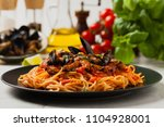 spaghetti with mussels. front... | Shutterstock . vector #1104928001