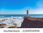 girl with arms wide open... | Shutterstock . vector #1104933944