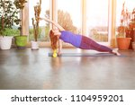 woman stretching in room at... | Shutterstock . vector #1104959201