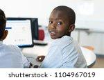 african young boy using... | Shutterstock . vector #1104967019