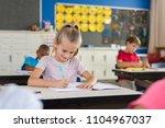 portrait of happy girl sitting... | Shutterstock . vector #1104967037