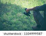 young man hand is holding a... | Shutterstock . vector #1104999587