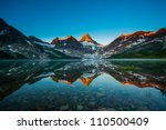 Stock photo reflection of mount assiniboine on magog lake at sunrise alberta canada 110500409