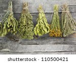Variety Of Dried Herbs On An...