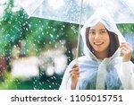 rainy day asian woman wearing a ...   Shutterstock . vector #1105015751
