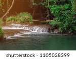the beauty of the waterfall and ... | Shutterstock . vector #1105028399