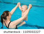 mother teaching happy little... | Shutterstock . vector #1105032227