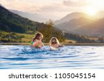 kids play in outdoor infinity... | Shutterstock . vector #1105045154