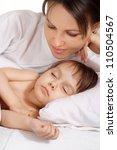 little girl lying on bed at home | Shutterstock . vector #110504567