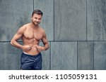 fit muscular shirtless young... | Shutterstock . vector #1105059131