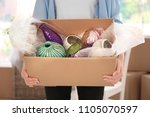 woman with packed carton box...   Shutterstock . vector #1105070597