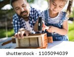 father with a small daughter...   Shutterstock . vector #1105094039