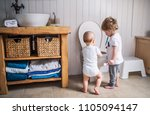 two toddler children with... | Shutterstock . vector #1105094147