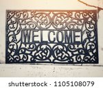 vintage welcome mat on concrete ... | Shutterstock . vector #1105108079